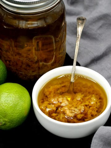 Mojo de Ajo in a bowl with limes