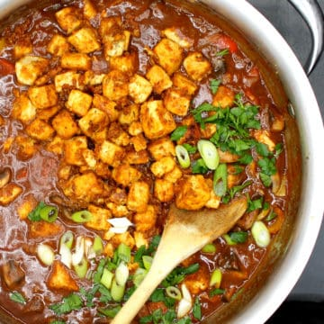 Vegan Etouffee in a pot with a spoon