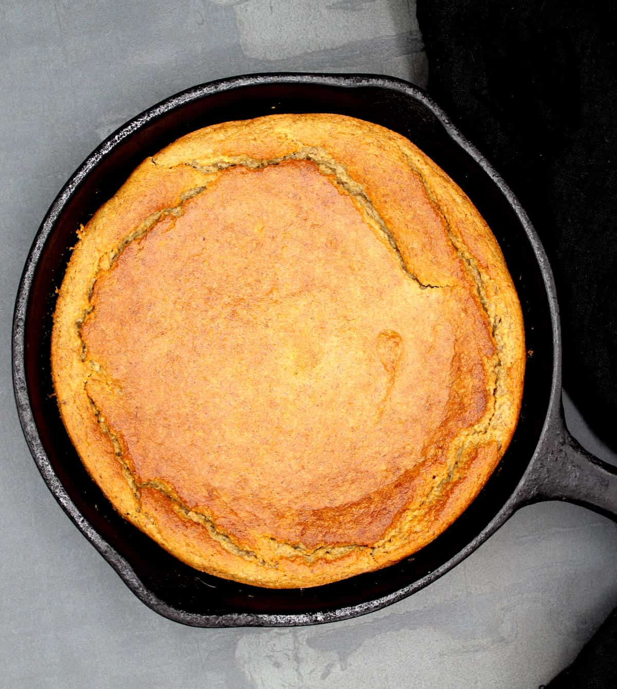 Vegan upside down banana cake in a cast iron skillet after baking and before unmolding.