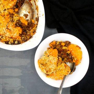 Vegan Sweet Potato Chili Bake in a white bowl and casserole dish