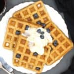 Vegan Waffles on a white plate with blueberries