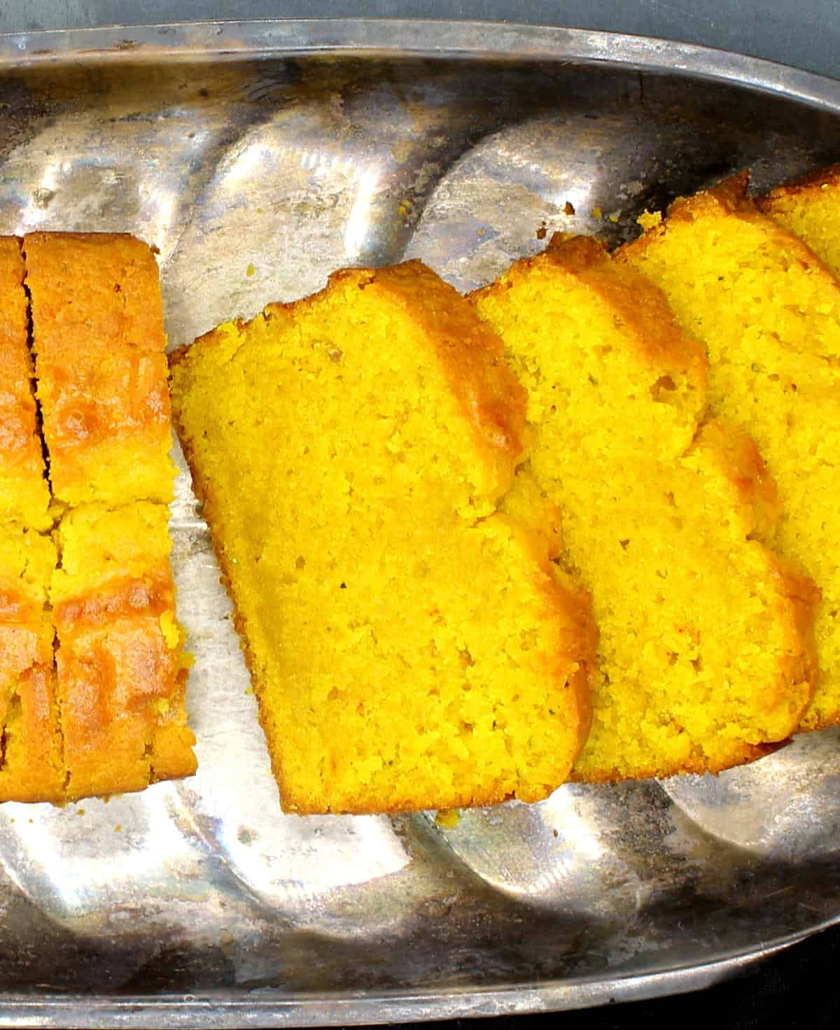 Close up of slices of vegan turmeric cake.