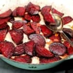 Vegan Garlic Butter Beets in a skillet with a spoon