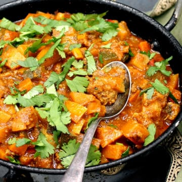 Vegan Indian Curry in a karahi with a spoon