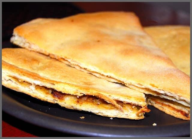 Photo of stacked slices of vegan berber pizza.