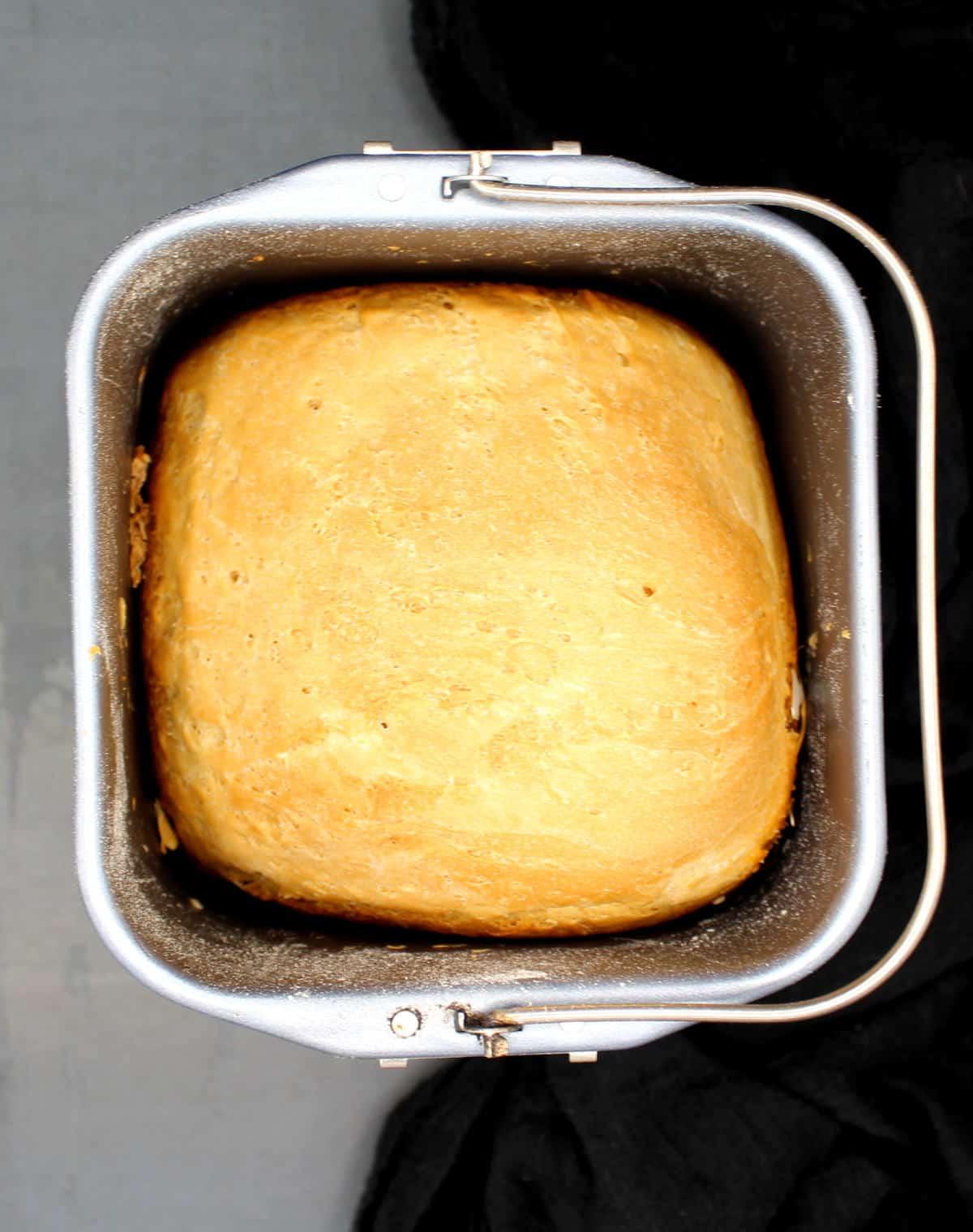 Sourdough loaf inside a breadmaker basket.