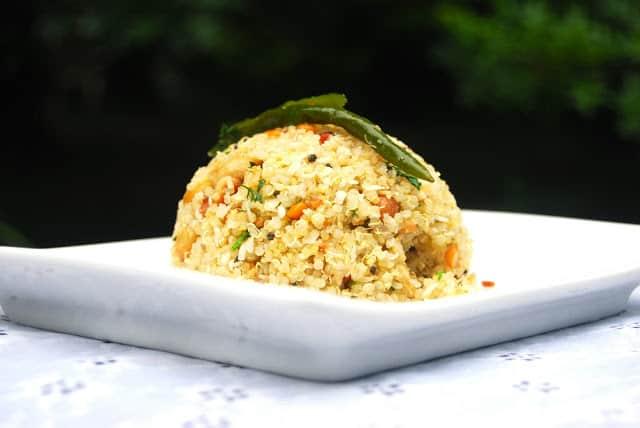 Photo of coconut quinoa on white plate.