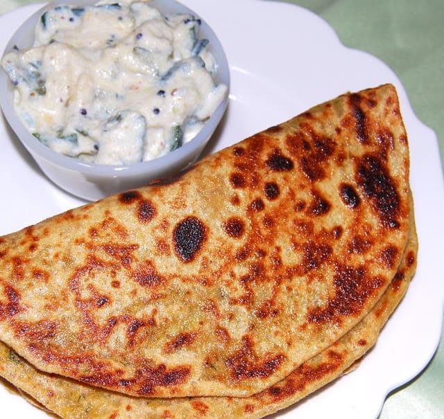 Photo of gobi paratha served with vegan raita.