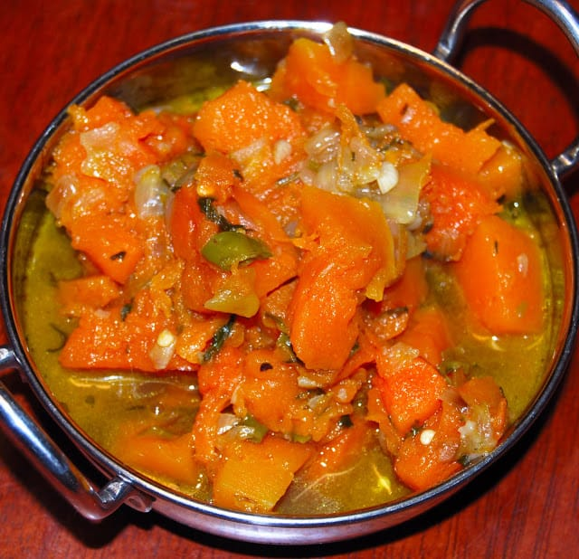 Photo of a spiced and herbed pumpkin side dish.