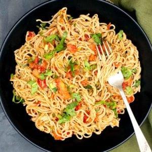 Photo of chilli garlic ramen noodles in a black bowl