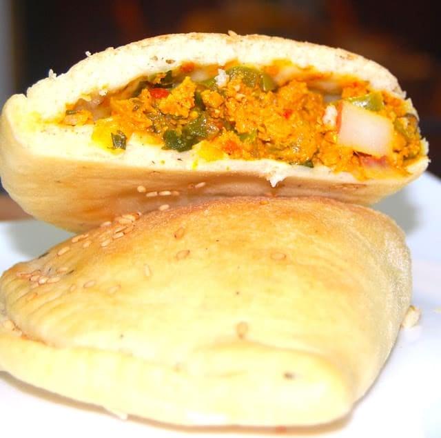 Photo of a cross-section of keema-stuffed naan calzone.