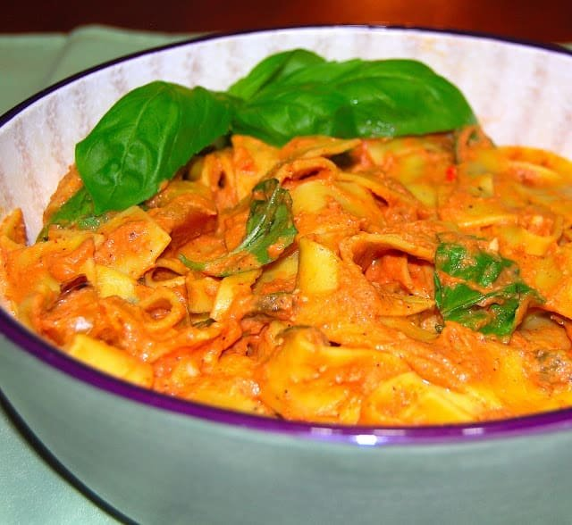 Photo of pappardelle pasta with a creamy tomato chipotle sauce with Mexican flavors.