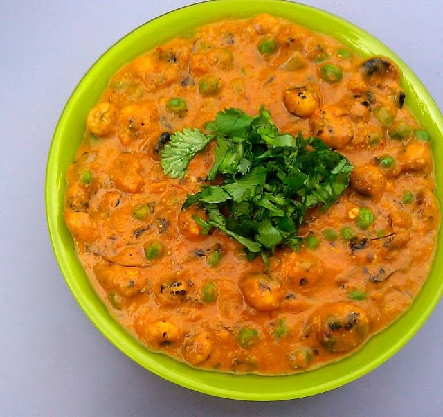 Closeup of lotus seed curry or phool makhana curry with green peas and cilantro.