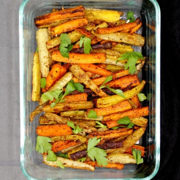 Roasted carrots with middle eastern spice mix za'atar in a glass baking dish