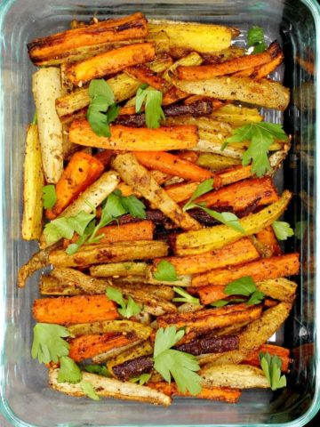 Roasted multicolored carrots in a baking dish
