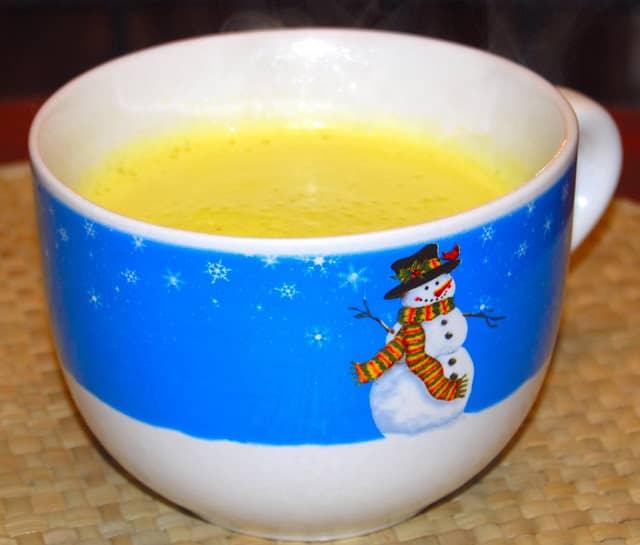 Photo of a large cup of vegan turmeric milk or golden milk or haldi ka doodh