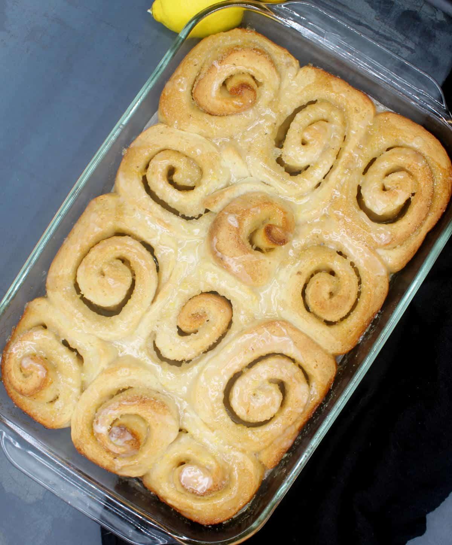 Baking dish with vegan lemon sweet rolls.