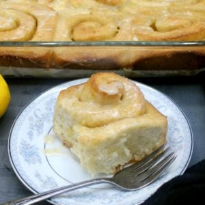 Vegan lemon roll on a blue and white plate with fork