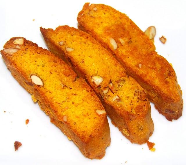 Photo of vegan mango biscotti on a white background.