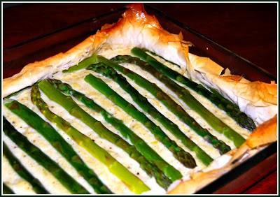 Photo of a vegan asparagus and potato tart with