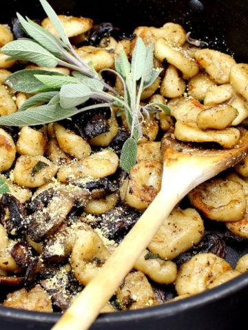 Vegan Sage Butter Gnocchi pasta in a pan with wooden spoon