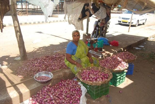 Photo of woman selling onions at Madurai market