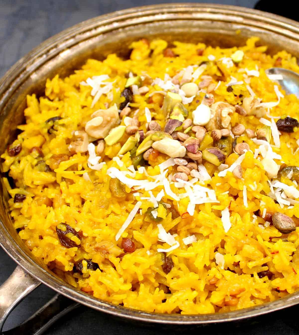 Closeup of vegan zarda in a silver serving bowl.
