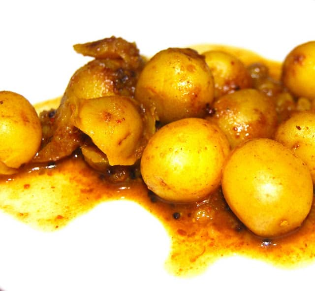 Photo of sweet and sour Gujarati potatoes in a tangy, spicy sauce.