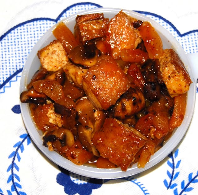 Overhead photo of chewy tofu in a Mexican sauce of apricots, tamarind and chipotle.