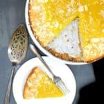 Photo of a slice of vegan lemon cake on a plate.