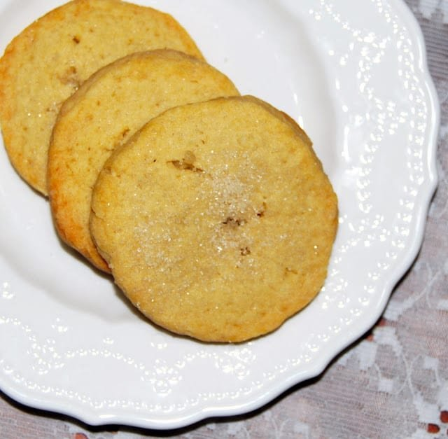 Photo of French Sable cookies on a decorative white plate.