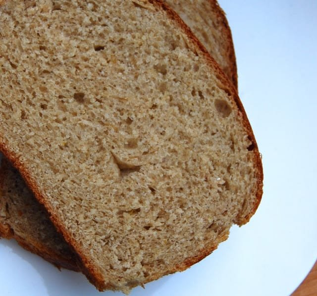Photo showing a closeup of a slice of whole wheat maple oatmeal bread.