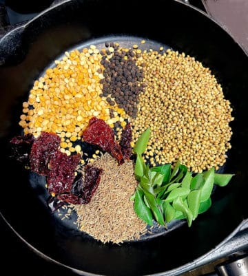 Spices for curry powder in a cast iron skillet