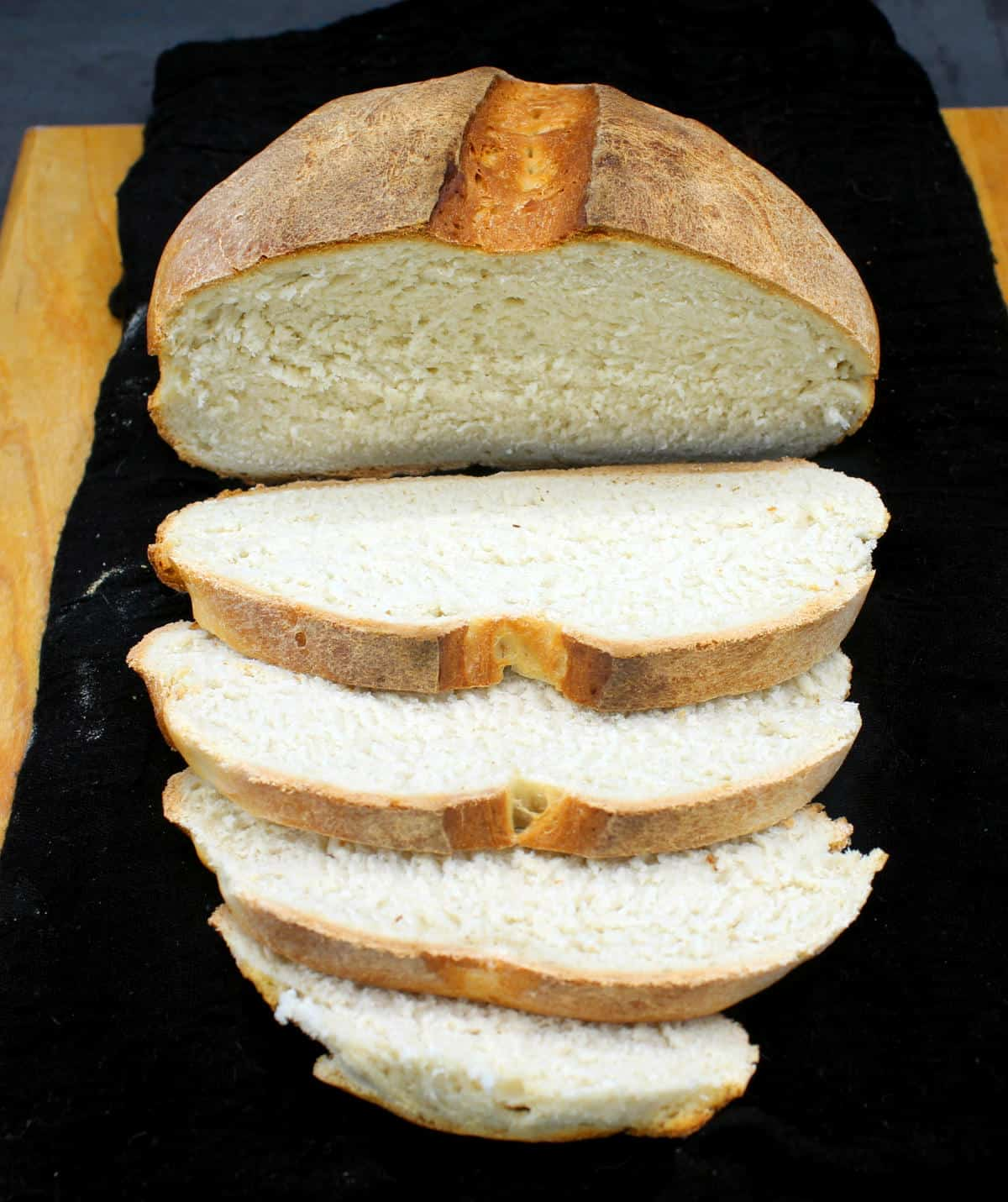 A sliced loaf of one-hour sourdough bread.