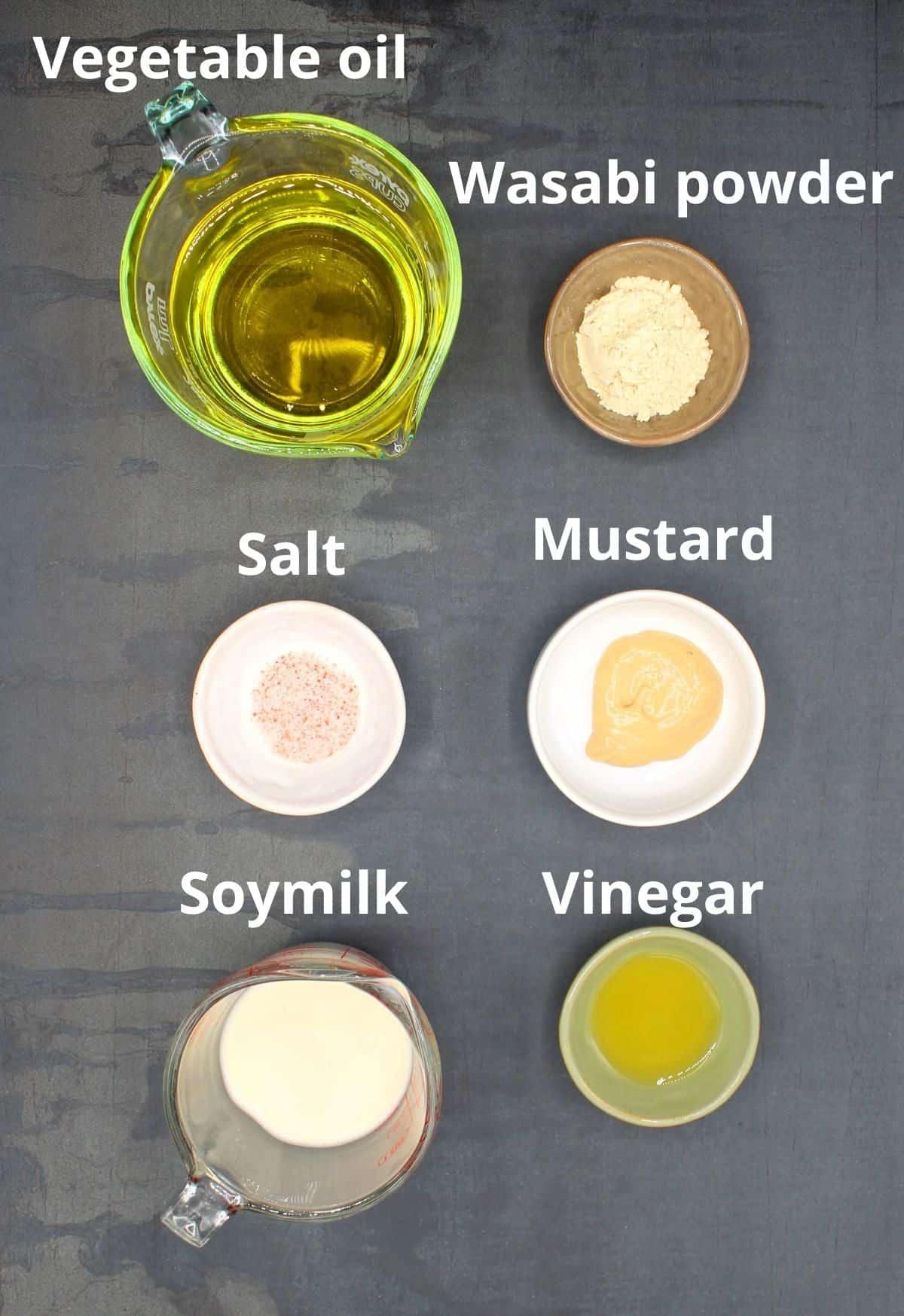 Photo of ingredients for vegan mayonnaise including oil, soymilk, vinegar, mustard, wasabi and salt.
