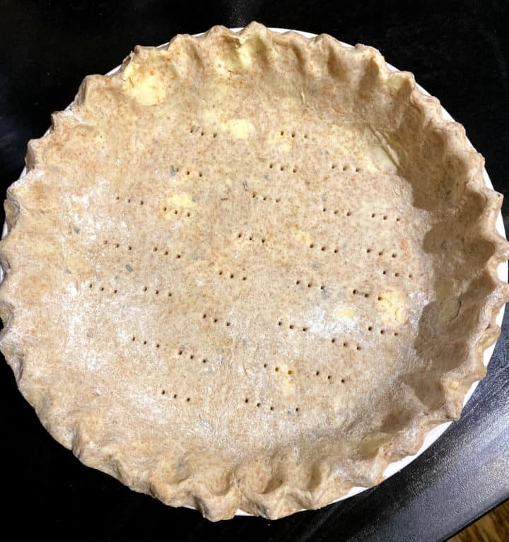 Pie crust with bottom poked with tines of fork