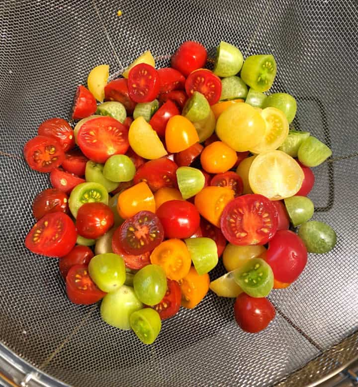Tomatoes straining in colander