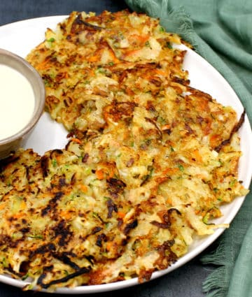 Vegan hash browns in a white plate