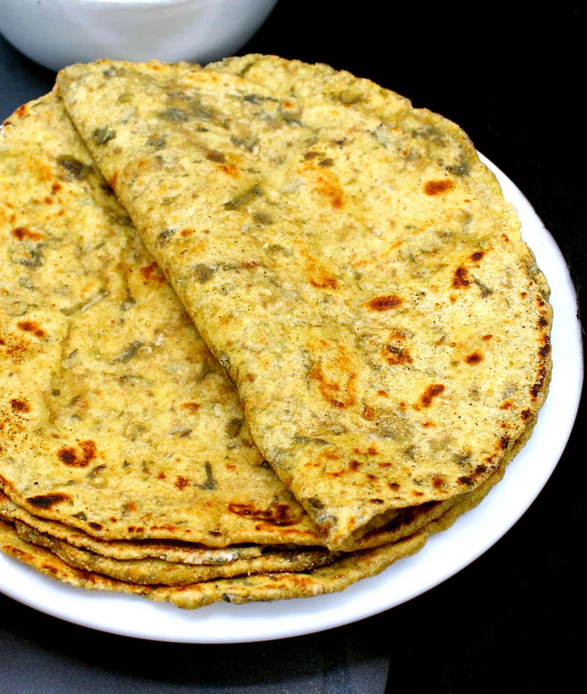 Front closeup of spinach paratha or palak paratha.