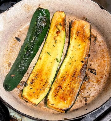 Roasted, golden-brown zucchini in skillet