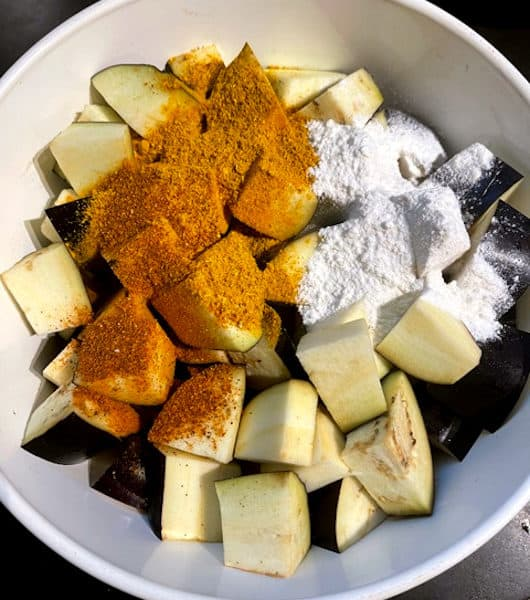 Cubed eggplants with spices in bowl