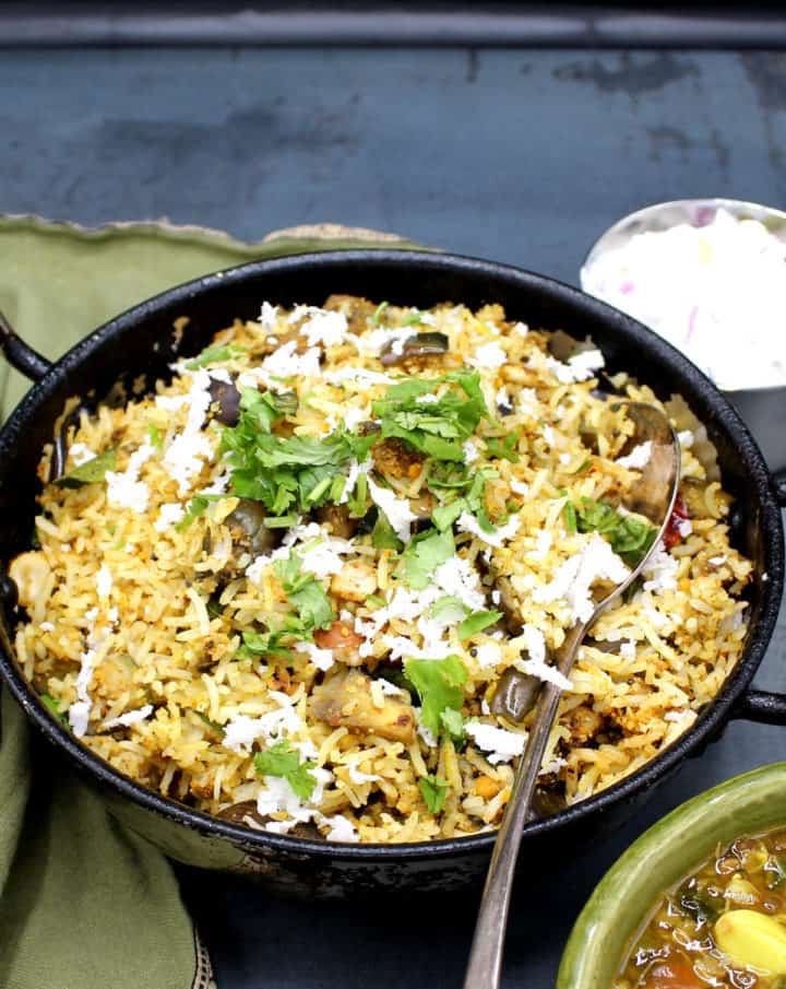 Finished eggplant rice or vankee bath in a steel karahi with cilantro and coconut