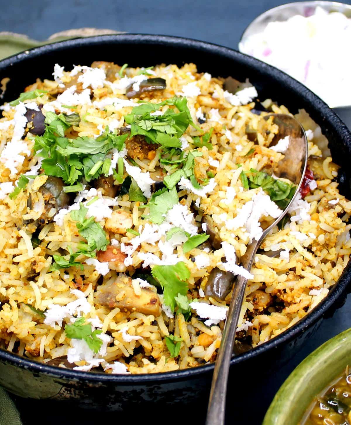 Closeup photo of vangi bath or Tamil eggplant rice.