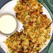 Vegan Hash browns in a white plate with a creamy sauce