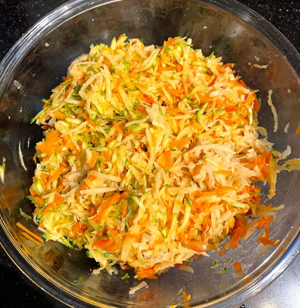 Salted veggies in bowl for hash browns