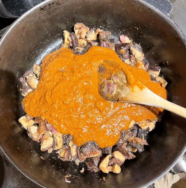 Masala spices added to onions for xacuti gravy