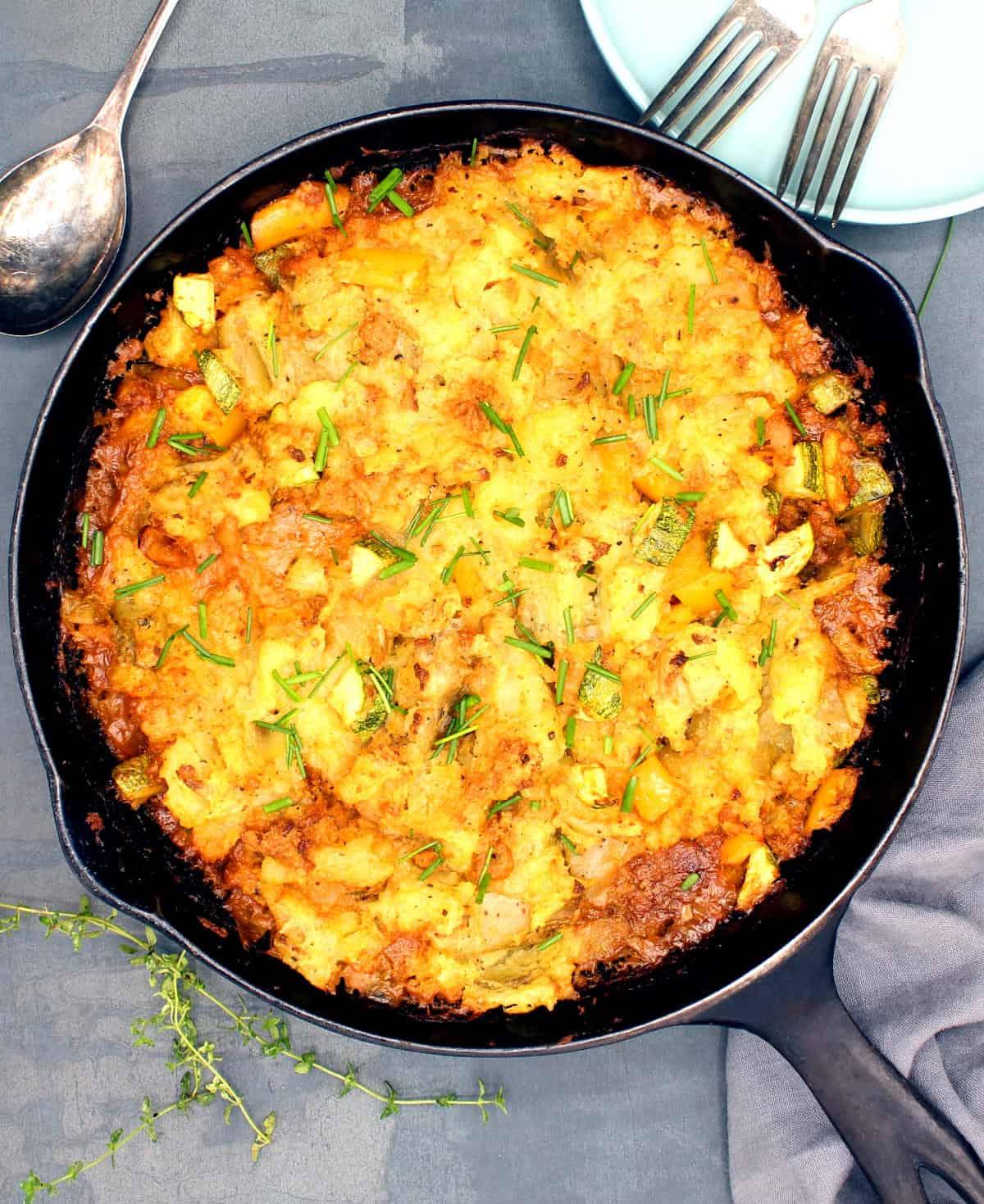 Cheesy vegan dinner bake in cast iron pan