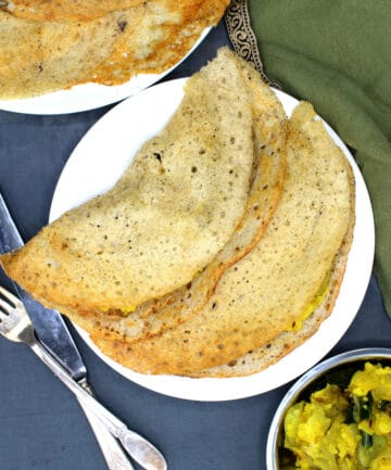 Cooked sorghum dosa served in a plate with potato sabzi