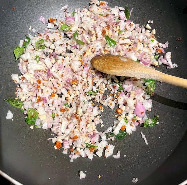 Shallots frying in pan