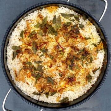 Cooked vegan dum aloo biryani in pot